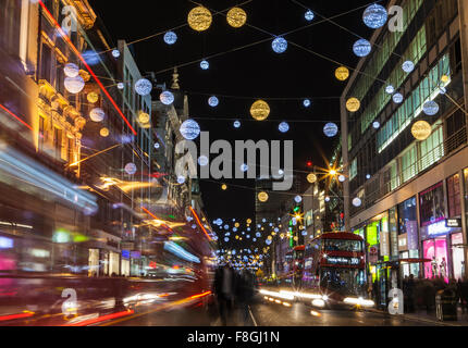 LONDON, UK - DECEMBER 9TH 2015: A view of a busy Oxford Street during the lead up to Christmas in London, on 9th - Stock Photo