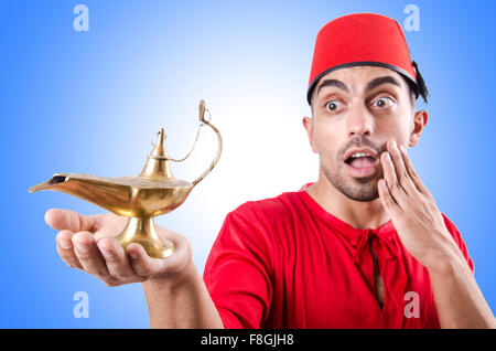Turk man with lamp on white - Stock Photo