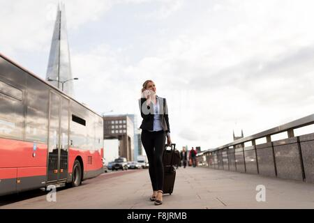 Businesswoman on business trip, London, UK - Stock Photo