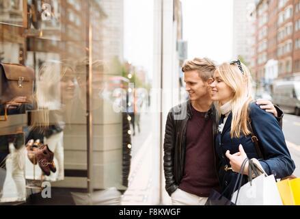 Young couple window shopping, London, England, UK - Stock Photo
