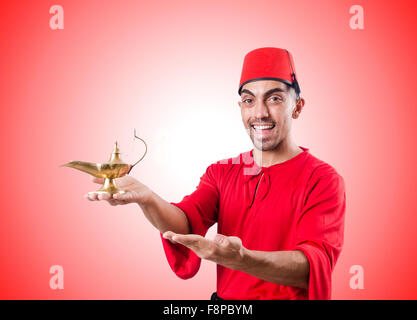 Turkish man with lamp on white - Stock Photo