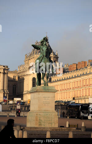 A bronze statue of Louis XIV astride a horse in front of the Chateau Versailles on the outskirts of Paris, France. - Stock Photo