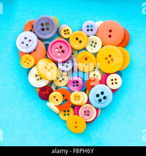 Colorful buttons in the shape of a heart on a retro background - Stock Photo