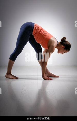 Woman stretching in Ashtanga Vinyasa yoga asana - Stock Photo