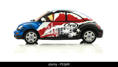 VW Beetle in Race Trim  Die cast model in Arai colours and Logo  on a white background. - Stock Photo