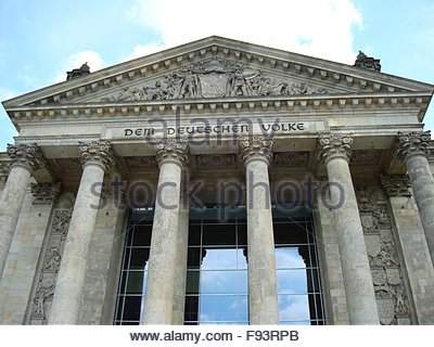 Inscription at entrance of Reichstag building - Stock Photo