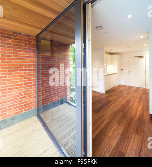 One Church Square, London, UK. View of the inside and outside of a modern apartment. Lounge area with wood floors. - Stock Photo