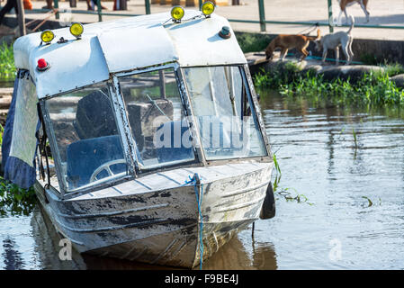 Old abandoned boat in the Amazon River in Leticia, Colombia - Stock Photo