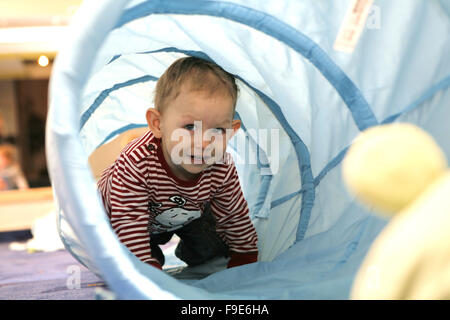 Toddler Boy Crawling in Tunnel - Stock Photo