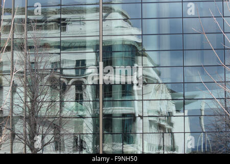 A reflection of a an old building in a modern glass building in budapest - Stock Photo