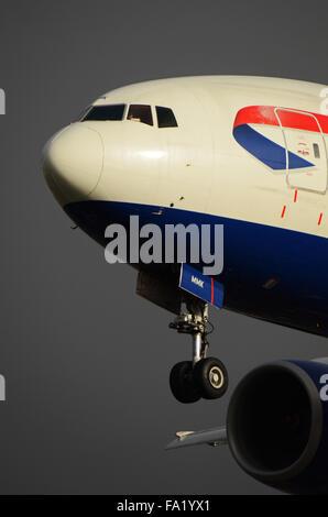 British Airways Boeing 777 -236 (ER) - G-YMMK landing at London Heathrow Airport. Space for copy - Stock Photo