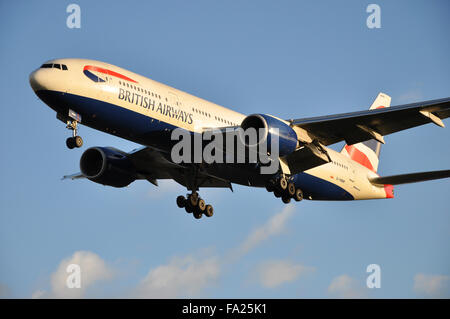 G-YMMR British Airways Boeing 777-236(ER) - cn 36516 / 771 landing at London Heathrow Airport with glow from setting - Stock Photo