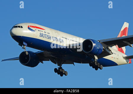 British Airways Boeing 777-236(ER) - G-VIIY coming in to land at London Heathrow. Space for copy - Stock Photo