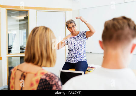 high school students with professor stock photo royalty free image 66373582 alamy. Black Bedroom Furniture Sets. Home Design Ideas