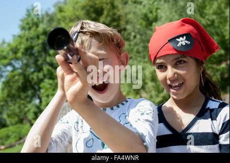 Children playing pirate game in adventure playground, Bavaria, Germany - Stock Photo