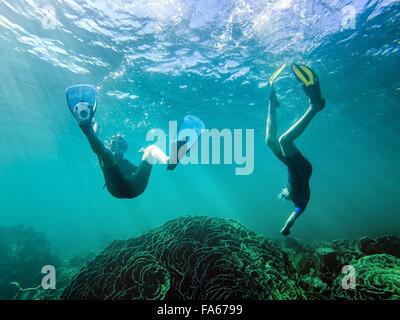 Boy and girl swimming underwater, Exmouth, Western Australia, Australia - Stock Photo