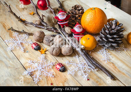 Tangerines, oranges, nuts with cones and toys on  boards - Stock Photo