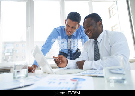 Businessmen working in team and using laptop - Stock Photo