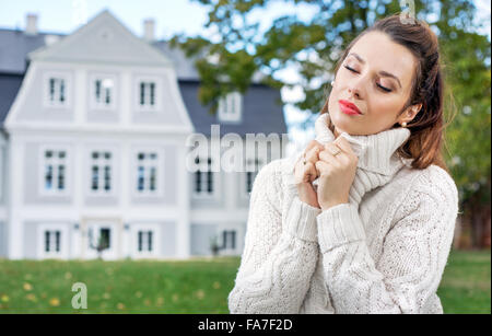 Charming young woman in her autumn garden - Stock Photo