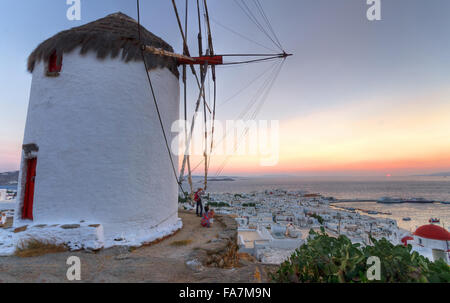 Greece, Cyclades Islands, Mykonos, typical windmill at sunset - Stock Photo