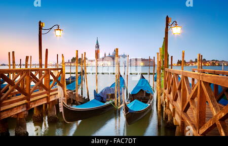 Venetian gondola moored on Grand Canal (Canal Grande) and San Giorgio Maggiore Church in background, Venice, Italy - Stock Photo