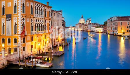 Evening at Canal Grande (Grand Canal) , Santa Maria della Salute basilica, Venice, Veneto, Italy - Stock Photo