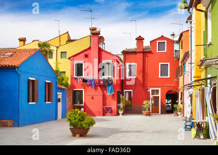 Multicolored houses in Burano Island near Venice, Italy - Stock Photo