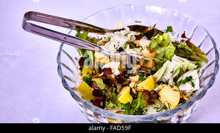 Salad with pears, nuts and greens - Stock Photo