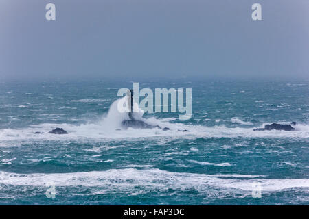 Waves Crashing On Longships Lighthouse. Lands End, Cornwall, UK. Strong Winds, 60pmh Gusts, 2nd January 2016. Credit: - Stock Photo