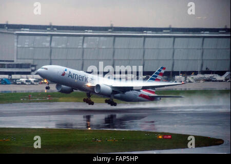London, UK, 02 January 2016, Planes continue to take off in heavy rain and mist at Heathrow Airport as storm Frank - Stock Photo