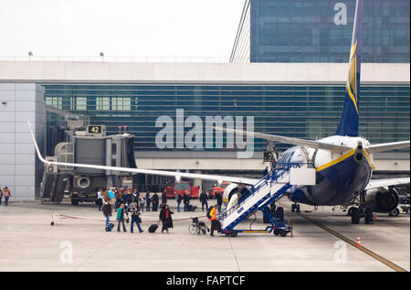 Passengers boarding a Ryanair low cost airline Boeing 737 parked on Stock Photo, Royalty Free ...