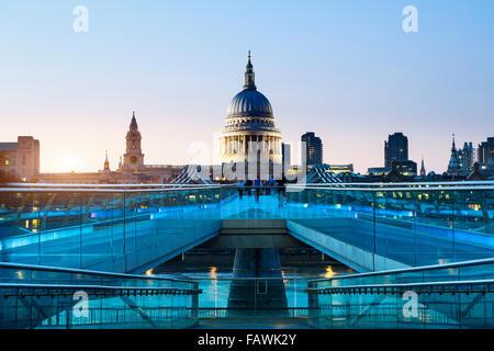 London, Millennium bridge illuminated - Stock Photo