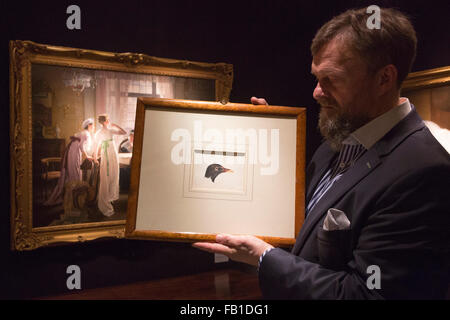 London, UK. 7 January 2016. An art dealer of Haynes Fine Art holds up the Study of a Head of a Moorhen by Joseph - Stock Photo