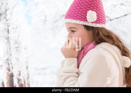 Teen girl freezing outdoor winter - Stock Photo