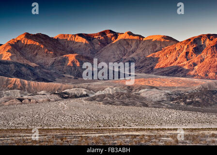 Owlshead Mountains over Confidence Hills in Mojave Desert, sunrise from Jubilee Pass Road, Death Valley Nat Park, - Stock Photo
