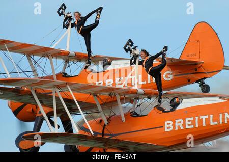 AeroSuperBatics Ltd is a British aerobatics and wingwalking team. As of 2011, they perform as the Breitling Wingwalkers. - Stock Photo