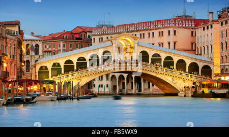 Rialto Bridge at evening, Grande Canal, Venice cityscape, Italy, UNESCO - Stock Photo