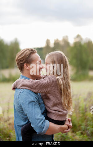 Finland, Uusimaa, Raasepori, Karjaa, Father and daughter (6-7) rubbing noses - Stock Photo