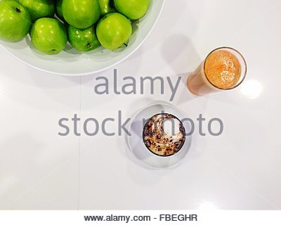 High Angle View Of Granny Smith Apples With Juice And Cappuccino Served On Table - Stockfoto