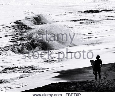 Surfer Looking At Waves - Stock Photo