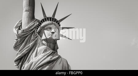 Panoramic close-up of the Statue of Liberty in Black & White including head, crown and arm. Liberty Island, New - Stock Photo