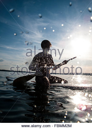 Man Stand Up Paddling On The Sea - Stockfoto