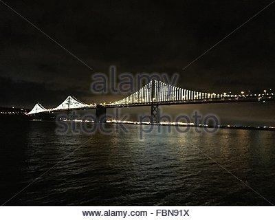 Scenic View Of Illuminated San Francisco-Oakland Bay Bridge At Night - Stock Photo