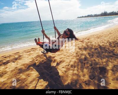 Woman On Beach Swing - Stock Photo