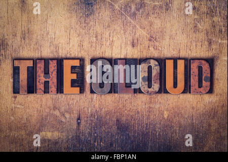 The word 'The Cloud' written in dirty vintage letterpress type on a aged wooden background. - Stock Photo