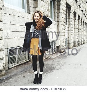 Full Length Happy Teenage Girl On Street - Stock Photo