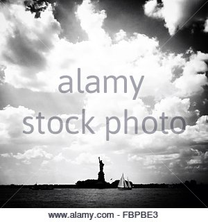 Silhouette Statue Of Liberty Against Cloudy Sky - Stock Photo