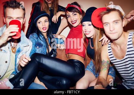 Swag girls and guys having party in bar - Stock Photo