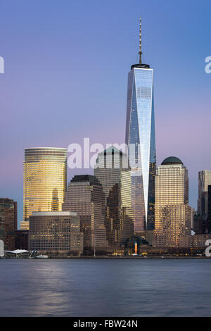 One World Trade Center (Freedom Tower) standing tall at twilight in the Financial District of Lower Manhattan, New - Stock Photo