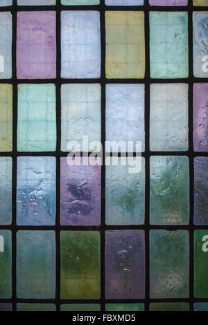 colored stained glass window with regular block pattern blue green tone - Stockfoto